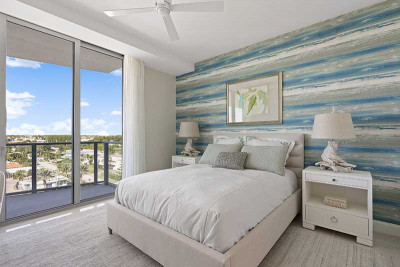 Model home bedroom with view of Singer Island and intracoastal