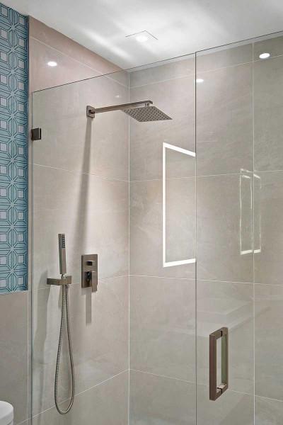 Amrit luxury residences glass enclosed rain shower