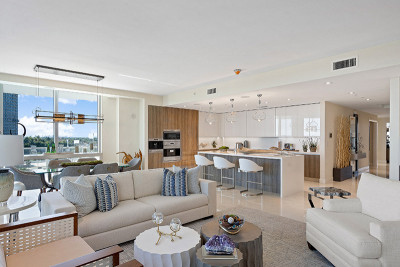 Open concept oceanfront living, dining, and kitchen area with luxury finishes and view of Singer Island beach