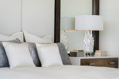 Custom luxury headboard and night stand in master bedroom