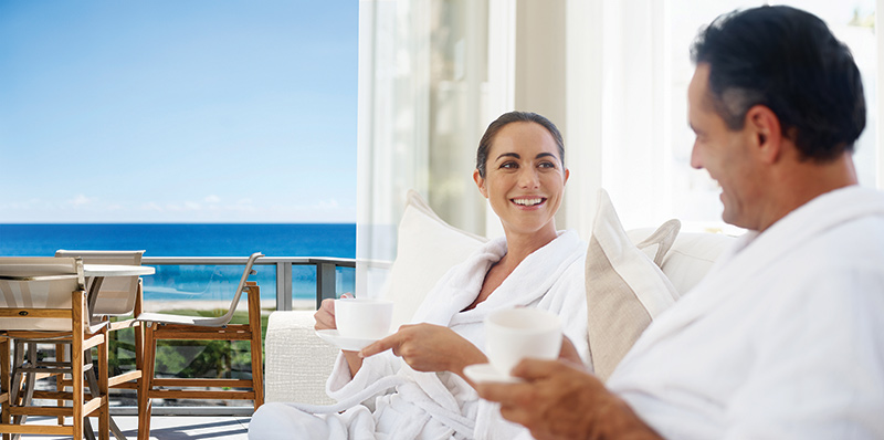 Couple enjoying ocean view from private oversized terrace